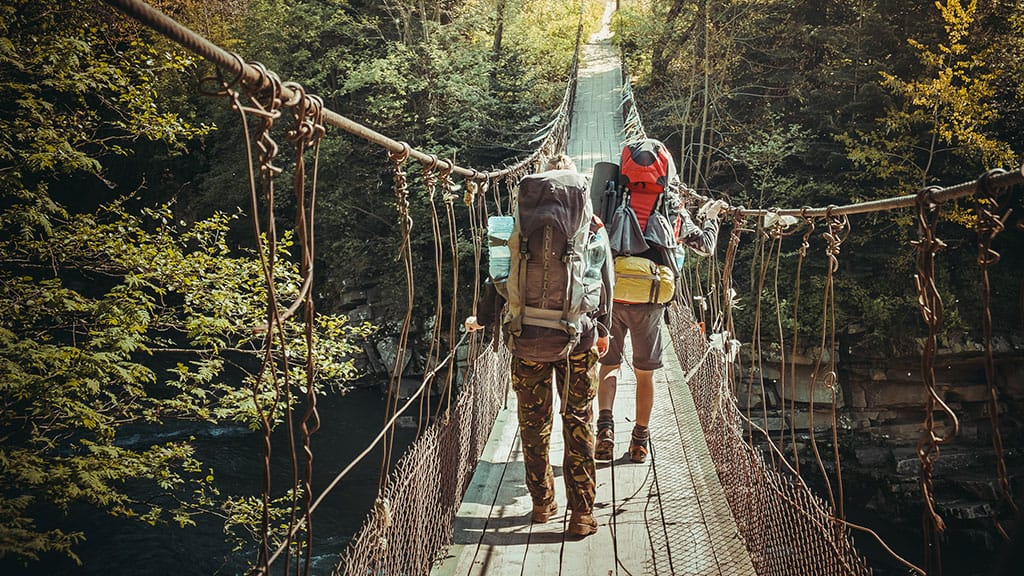 travelers-crossing-through-hanging-bridge.jpg